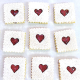 Valentines Day - homemade butter cookies with red raspberry jam.