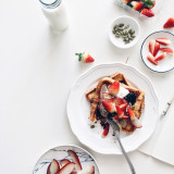 French toast with strawberries, rose apple, pumpkin seeds, blueberry jam and yogurt.