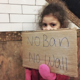 Child holding a protest sign