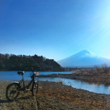 Lone bike facing Mount Fuji on the outskirts of Lake Kawaguchi.