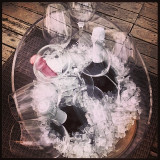 Bottles of wine and glasses in ice