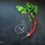 Beetroot laying on chalkboard
