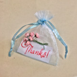 Thank you note in a blue bag