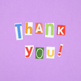 Thank you! Cut out magazine letters on a purple background.