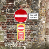 Traffic signs on old brick wall
