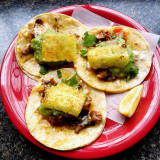 Delicious carne asada tacos with pineapple and guacamole.