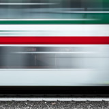 Blurred motion of the train with italian flag colors