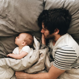 father and son sleeping in bed