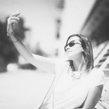 Happy young woman making a selfie - monochrome