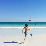 Beach babe kicking a ball! Summertime in Destin, FL