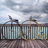 Bicycles by the sea… Penny farthings on the pier