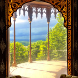 A view of the Hudson River and the Catskills Mountains from a room in artist Frederic Church's home, Olana.There is a protective screen over the window to keep furniture and other objects from sun damage. The screen gives the appearance of a very soft and muted landscape.