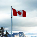 Flag waving with snowcapped mountain in the background