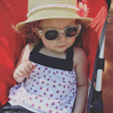 Summertime strolling - cute toddler girl in stroller wearing sunglasses and a hat in the summer sun*nominated*
