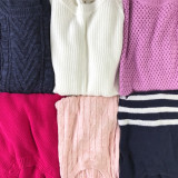 Six sweaters of different colors and textures.