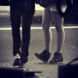 A guy and a girl at a bus stop