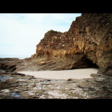 picture of a cave at a rocky and sandy beach in Costa Rica