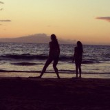 My betfriend and I were taking photos of he beach and these other 2 girls were playing in the sand.