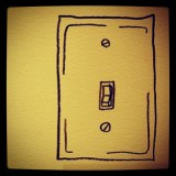 Yellow light switch. Definitely a quirky wall piece
