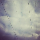 The power lines in the beautiful sky. It was an amazing day.