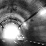 dynamic motion coming to end of tunnel meeting the light