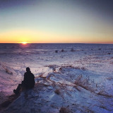 Taking in the marvel of the frozen sunset at Lake Michigan