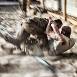 Two soldiers wresteling mongolian style, on Mongolias national day in Afghanistan.