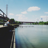 An averaged shot of a woman being very still down by the Cumberland River.