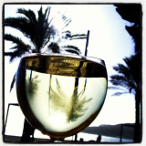 a glass of chilled white wine on the beach in sisimbra, portugal