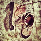 Militaristic picture creates nice camouflage between the shoes and the floor.