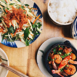 Flat lay wooden table with vietnamese dishes