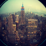 Taken from a recent trip to the Top of The Rock (GE building / NBC - where they film 30 Rock) using the fisheye lens. It was sunset, and the city looked so pretty. That's the empire state building in the middle.