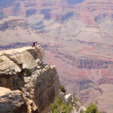 People sitting at a tip at the Grand Canyon!