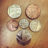 Who knew all the small change in your pocket fits together to make a coat of arms.