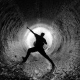Man astride in tunnel