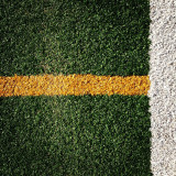 Abstract of lines of a hockey field showing differently colored artificial turf