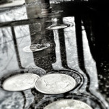 Coins in puddle
