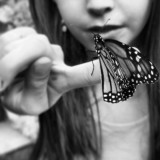 This picture was taken of my sister at the Stanely Hotel. they released lots of butterflies and they didn't mind if we held them. I cropped this picture so that it would just show her mouth and the butterfly.
