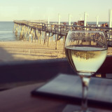 I love the way the pier is reflected in my glass of wine, and wanted to capture that perfect moment in the wind and sun.  With a cold drink, of course!