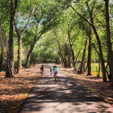 Kids riding bikes on the Provo River Parkway in Utah.