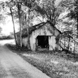 This photo was taken on a back country road outside of Makanda, Illinois. This place is off the grid as far as mobile phones are concerned. This old building reminds me of simpler times from the old days. Those days are long gone.