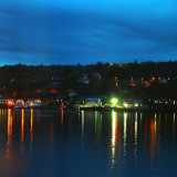 Taken while staying the night in Oban, Scotland. The multi-coloured lights of the port town reflected in the sea.