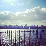 A view of the New York City skyline from the Jacqueline Kennedy Onassis Reservoir in Central Park