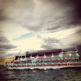 ferry to across toba lake , destination tomok at north sumatra - indonesia