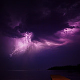 Summer storms bring powerful lightning that ignite the cold Montana sky.