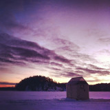 Early morning ice fishing on Mary lake in Port Sydney Ontario, Canada.