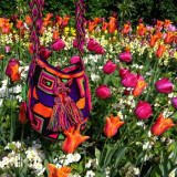 A handmade mochila, merging with the beautiful flowers at the flower garden in St James' Park, London.