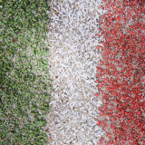 Abstract image of the edge of a tenniscourt resembling the Italian flag.