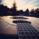 The sun setting behind a Yamaha Guitar.