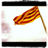 Catalan flag blowing in the wind during a visit to Barcelona